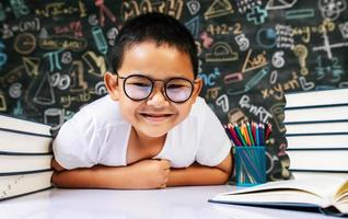 Child sitting and acting in the classroom photo