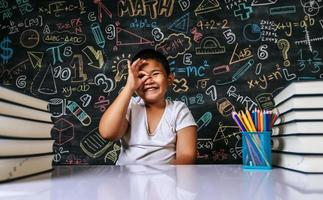 Child sitting and smiling in the classroom photo