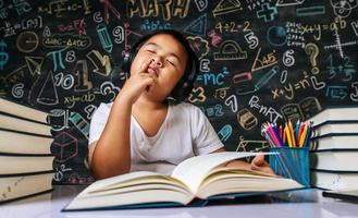 Child sitting and thinking in the classroom photo