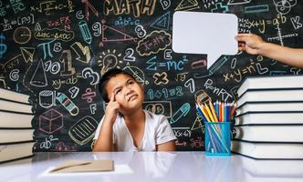 Child acting with speech bubble in the classroom photo