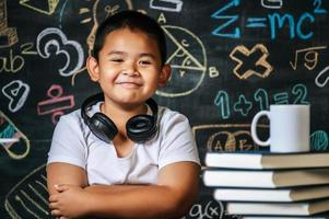 Child sitting with arms folded in the classroom photo