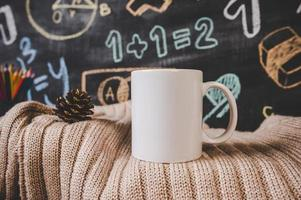 cup on the sweater in classroom photo