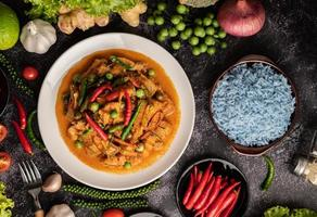 Red curry with pork in a white plate photo