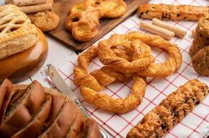 Various breads on red white cloth. Selective focus. photo
