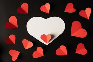 White hearts and red hearts made of paper are placed photo