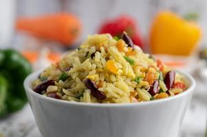 Mixed fried rice in a cup on a white wooden floor photo