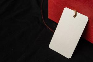 red gift box with clear tag photo