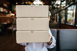 Woman holding a parcel box photo
