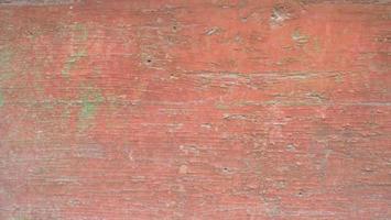 Placa de madera vintage retro imagen de fondo de textura pintada de rojo roto foto
