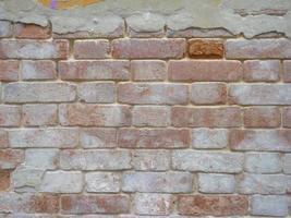 Imagen de fondo de textura de pared vieja de ladrillo vintage retro foto