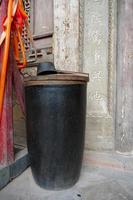 vat and ladle in front of a temple in Tianshui Wushan, Gansu China photo