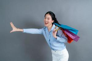 Asian woman holding shopping bags photo