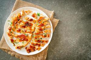 Grilled chicken breast sliced on plate photo