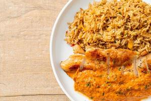 Grilled chicken steak with red curry sauce and rice photo