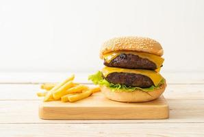 Hamburger or beef burgers with cheese and french fries photo