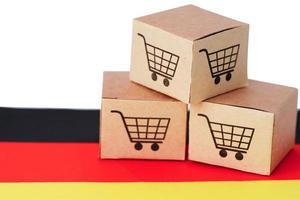 Cuadro de carro de compras en la bandera de Alemania, importación y exportación foto