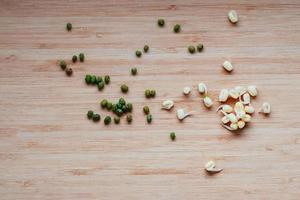 Mung beans and their sprouts on table, top view photo
