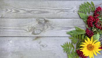 Wooden background with flowers and berries photo