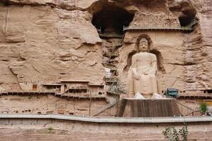 Ancient Chinese Buddha Statue at Bingling Cave Temple in Lanzhou China photo