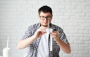Young man making windwill dummy photo