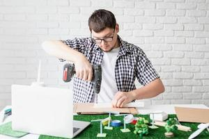 Young man teaching online making renewable energy dummy photo