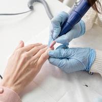 Manicure master using an electric machine photo