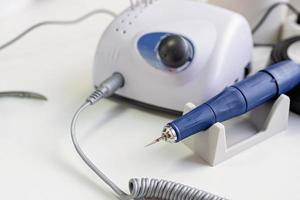 Nail drill or manicure machine on the table in nail salon photo