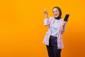 Cheerful asian woman holding Smartphone photo