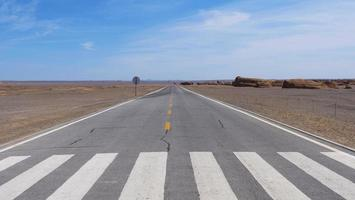 straight road in Dunhuang UNESCO Global Geopark, Gansu China. photo
