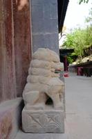 Stone lion statue in Tulou Temple of Beishan Mountain in Xining China. photo