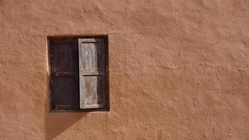 old house wall wooden window in Tuyoq village valley Xinjiang China photo