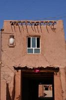 residential old house in Tuyoq village valley Xinjiang Province China. photo