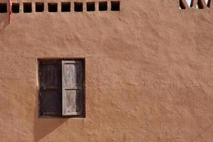 old house wall and wooden window Tuyoq village valleyXinjiang China. photo