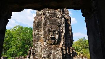 Face tower at the Bayon Temple, Siem Reap Cambodia photo