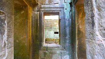 Stone ruin window at Ta Prohm Temple , Siem Reap Cambodia. photo