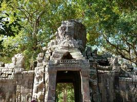 Stone door gate ruin at Banteay Kdei, in Siem Reap, Cambodia photo