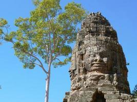 Stone carving of face at Banteay Kdei, in Siem Reap Cambodia photo