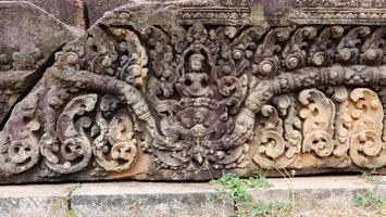 Stone carving art at buddhist khmer ruin of Pre Rup Siem Reap photo