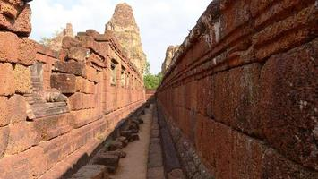 Stone rock wall at Ancient buddhist khmer ruin of Pre Rup, Siem Reap photo