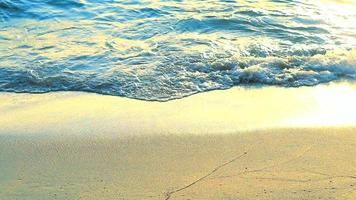 wave from sea to beach and reflection sunlight  little wave on sand video