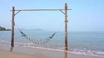Empty Hammock on the tropical beach sea ocean for leisure travel video