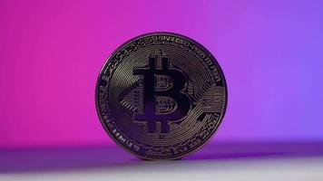 Bitcoin in Shadow and light. Cryptocurrency bitcoin and Pink Blue video