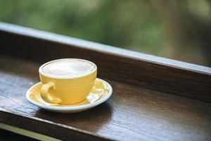 Coffee cup in coffee shop photo