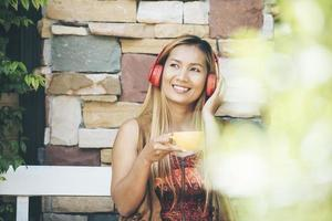 Happy young woman relax with listen favorite music at cafe photo