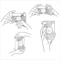 Hand holding camera. Sketch style vector