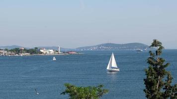 Sailboat going with sails at The Bay of Kalamis at Istanbul Kadikoy video