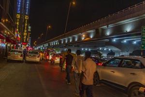 New-Delhi Delhi India- Nightlife big traffic on the road New-Delhi Delhi India photo