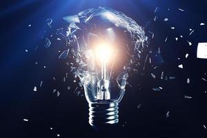 Exploding light bulb on a blue background photo