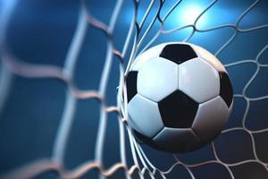 Balón de fútbol en red con foco o fondo claro del estadio foto