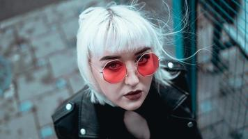 Portrait of woman with white hair and glasses. Modern urban style photo